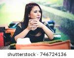 beautiful girl drinking coffee... | Shutterstock . vector #746724136
