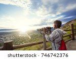 young boy looking out through... | Shutterstock . vector #746742376