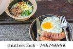 breakfast and wooden table... | Shutterstock . vector #746746996