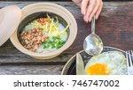breakfast and wooden table... | Shutterstock . vector #746747002