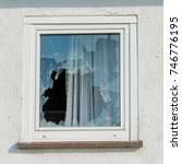 broken glass window outside | Shutterstock . vector #746776195