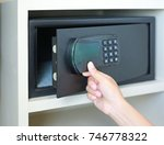 woman hand opens a safe hidden... | Shutterstock . vector #746778322