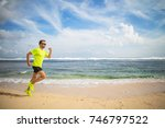 jogging on a tropical sandy... | Shutterstock . vector #746797522