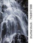 mountain waterfall falling on...   Shutterstock . vector #746847388