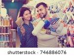 smiling  positive couple... | Shutterstock . vector #746886076