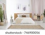 beige carpet in front of king... | Shutterstock . vector #746900056