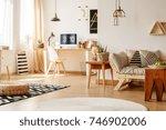 braided pouf on scandi carpet... | Shutterstock . vector #746902006