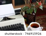 a typewriter  tea and a rose in ... | Shutterstock . vector #746915926