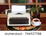 a typewriter  tea and a rose in ... | Shutterstock . vector #746927788