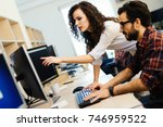 software engineers working on... | Shutterstock . vector #746959522
