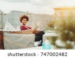 cheerful young black freelancer ... | Shutterstock . vector #747002482