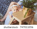 happy mother and 9 month old... | Shutterstock . vector #747011056