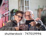 a young boy makes a selfie with ... | Shutterstock . vector #747019996