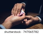 businessman closing a deal by... | Shutterstock . vector #747065782