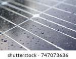 solar panel with rain drops on... | Shutterstock . vector #747073636