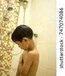 boy shower | Shutterstock . vector #747074086
