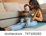 young mother playing with her... | Shutterstock . vector #747100282