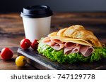 sandwich croissant with ham and ... | Shutterstock . vector #747129778