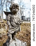 Statue Of Little Boy Angel At...