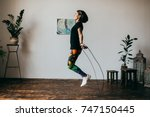Young Fitness Woman Jumping...