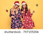 new year. two young woman with... | Shutterstock . vector #747155206