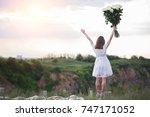 happy girl in a white dress... | Shutterstock . vector #747171052