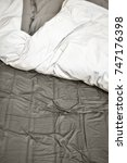 disheveled sheets and pillows... | Shutterstock . vector #747176398