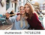 two happy smiling girls taking... | Shutterstock . vector #747181258