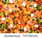 supreme pizza with broccoli and ... | Shutterstock . vector #747196192