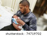 African American Man Holding...