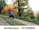 running mother with child in... | Shutterstock . vector #747200896