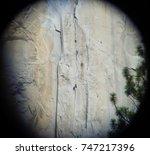 climbers ascend el capitan in... | Shutterstock . vector #747217396