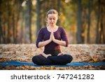 beautiful young woman meditates ... | Shutterstock . vector #747241282