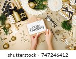 female hands hold merry... | Shutterstock . vector #747246412