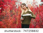 smiling girl pouring tea from... | Shutterstock . vector #747258832