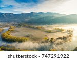 Small photo of The Eden valley - View of the Adda river during a foggy morning, Airuno, Italy