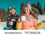 friends enjoying the winter day ... | Shutterstock . vector #747308236