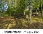 view of a park bench near... | Shutterstock . vector #747317152