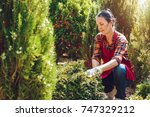 active senior woman gardener... | Shutterstock . vector #747329212
