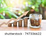 Small photo of coins money saving setting increase to profit concept investment fund finance and business