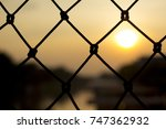 sunset and fence with canal... | Shutterstock . vector #747362932
