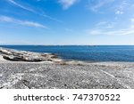 A Small Dinghy Sails Along The...