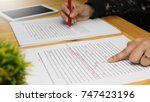 hand working on paper for... | Shutterstock . vector #747423196