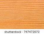 orange timber and rough surface.... | Shutterstock . vector #747472072