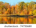 Reflections of brilliant autumn colors in a serene lake (Punderson Lake in northeast Ohio) - stock photo
