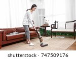asian housewife cleaned with a... | Shutterstock . vector #747509176