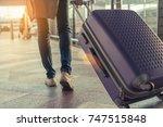 traveler with suitcase in... | Shutterstock . vector #747515848