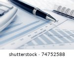 Business background, financial data concept with pen - stock photo