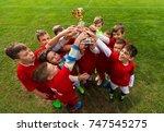 kids soccer football   young... | Shutterstock . vector #747545275