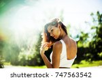 portrait of a girl in nature ... | Shutterstock . vector #747563542